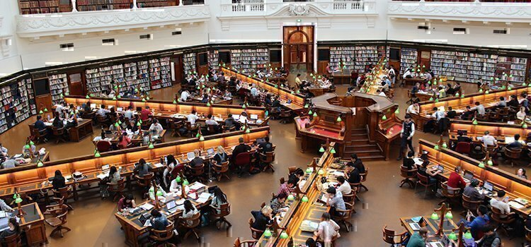 a picture of a library with students in it