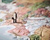 a tiny man on a map