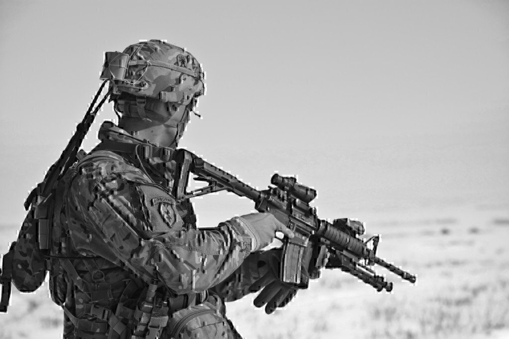 a military member with an m4