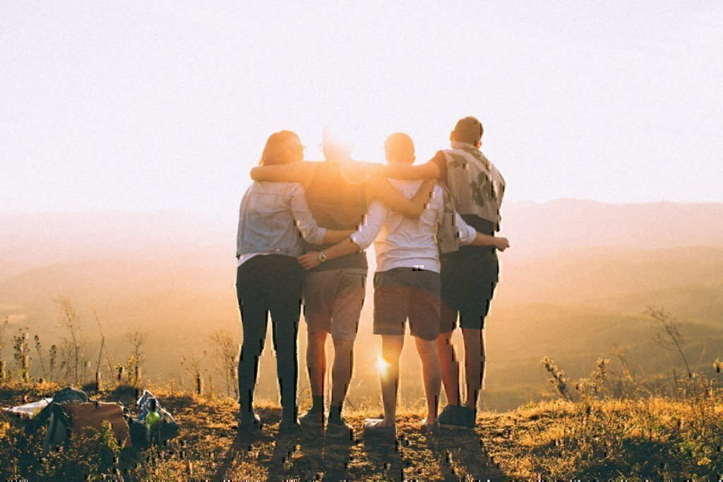 friends staring at the sunrise together