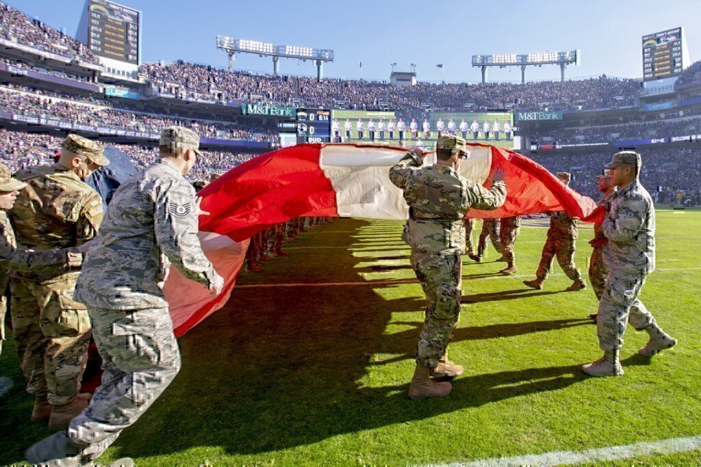 a group of soldiers holding a flag on a field