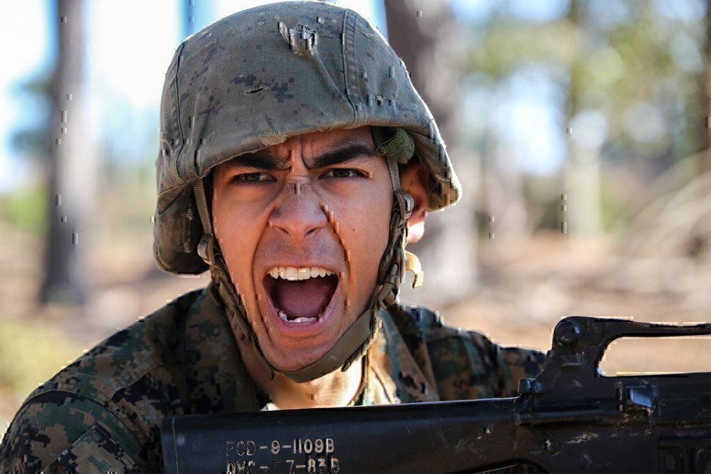 a soldier yelling at work