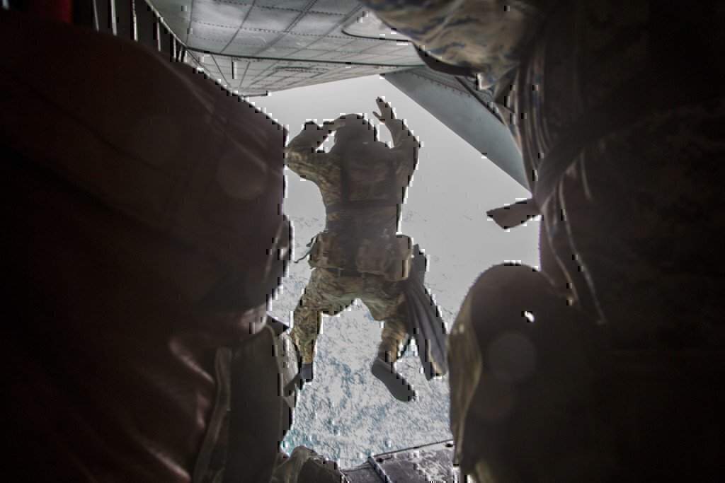 a man jumping out of an airplane