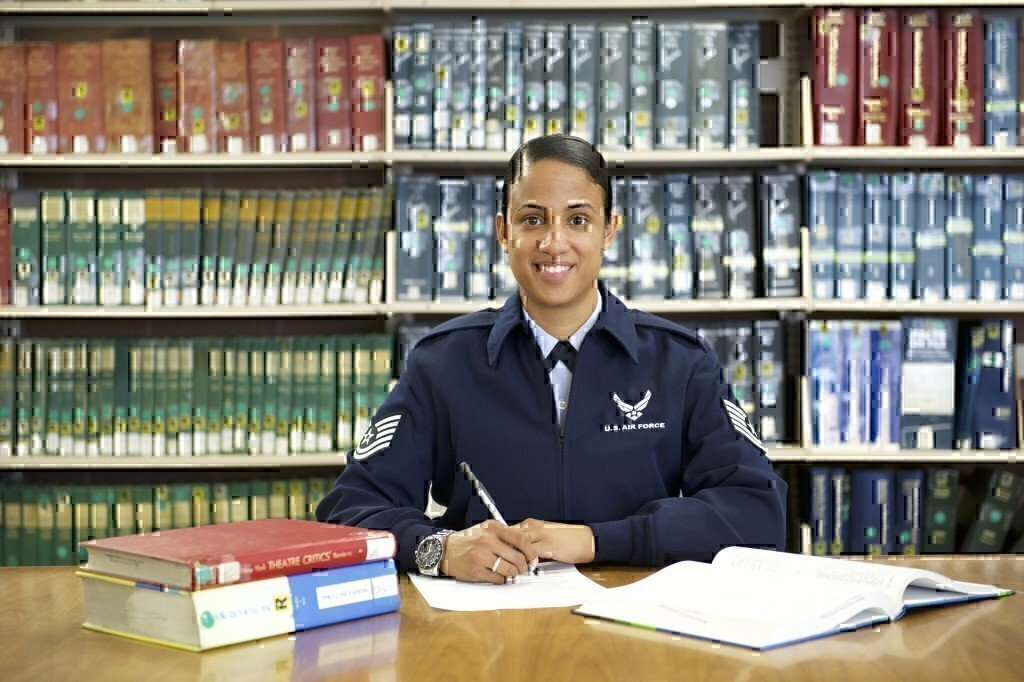 a woman airman working in a library