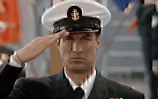 a navy sailor saluting