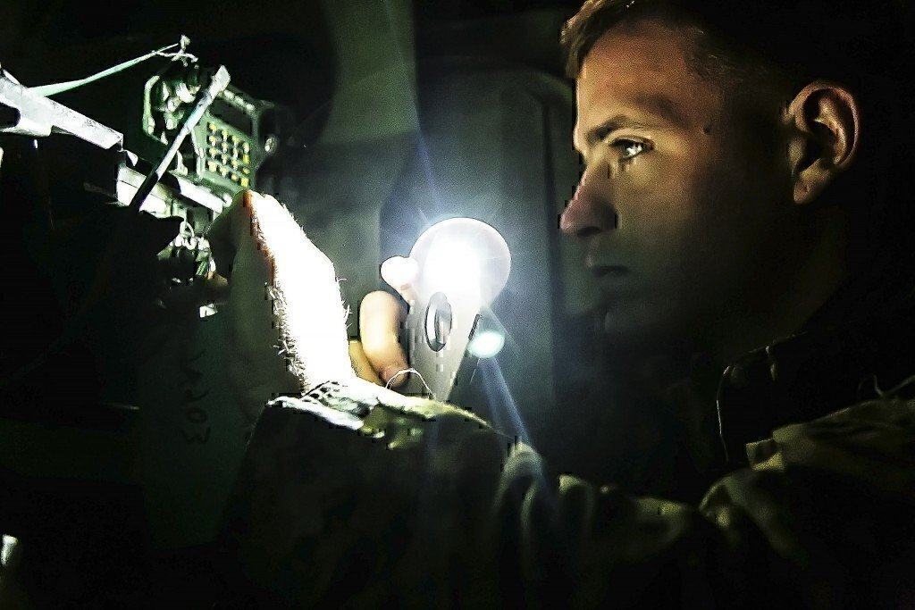 Photo shows a soldier working an IT Jobs