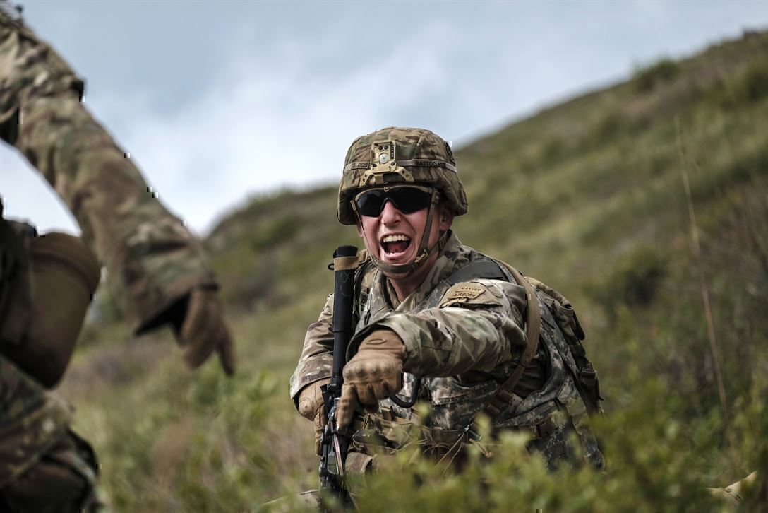 A soldier yells and points