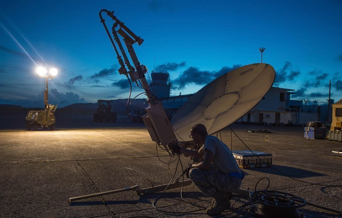 A Soldier checks a satellite. IT Jobs like this are common in the military
