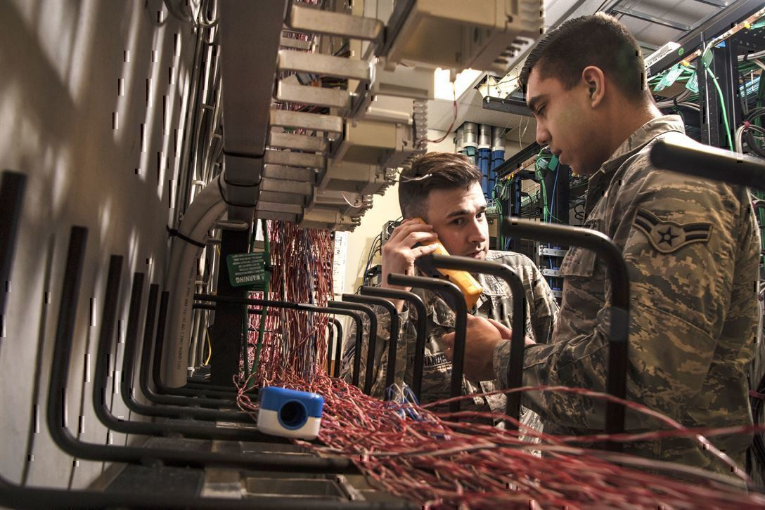 IT Jobs in the military give experience to service members like these air men, shown testing a system