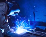a welder welds a piece of metal