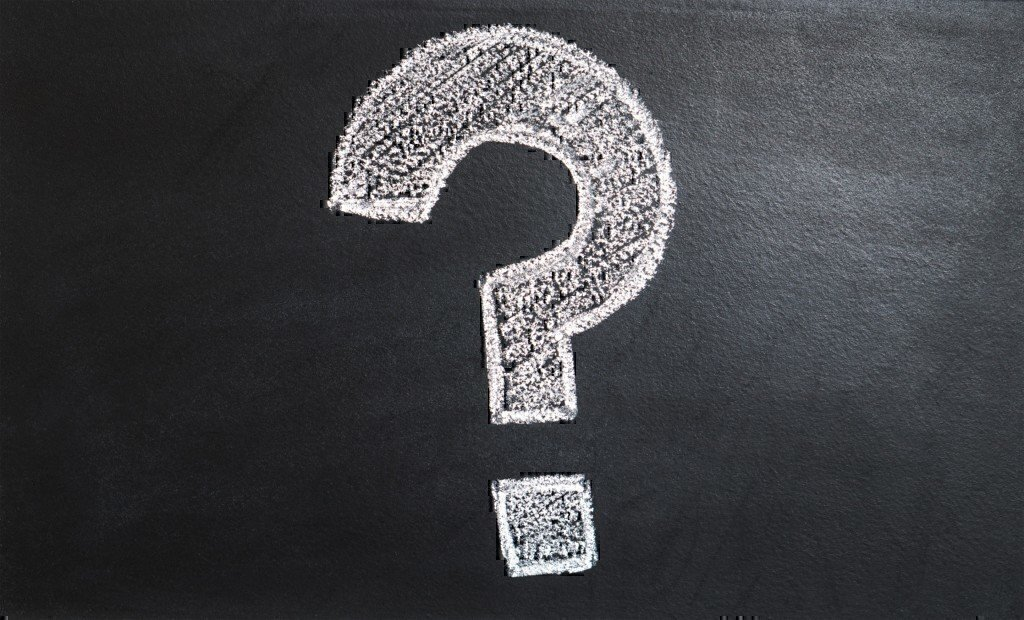 A question mark written in chalk