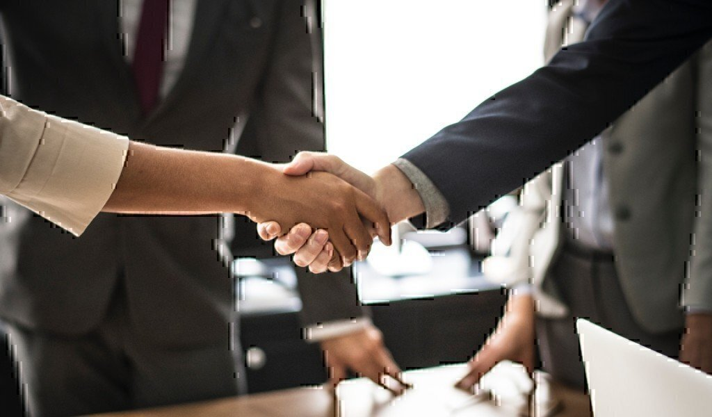 two business professionals shake hands