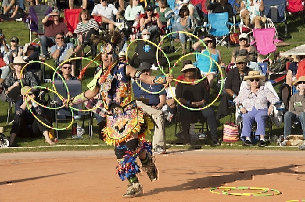 Army veteran performs a native american dance