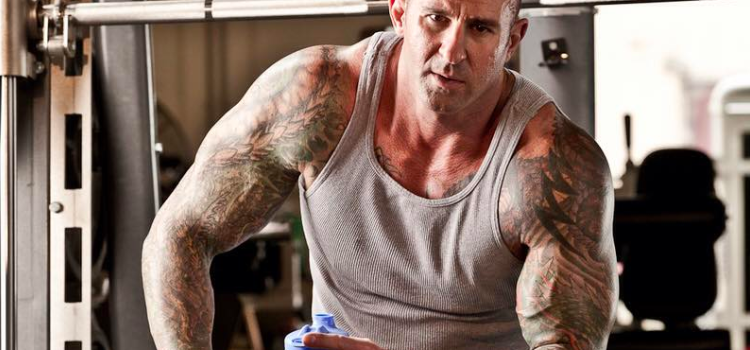 Jim Stoppani takes a break during a workout
