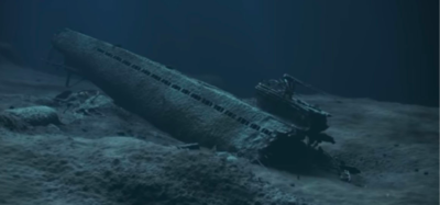 a wrecked submarine sits on the ocean floor
