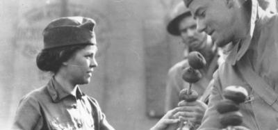 A world war one doughnut girl serves doughnuts