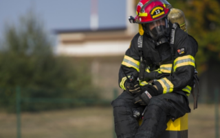 A firefighter wearing his suit