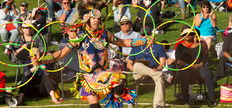 An army veteran performs a native american ritual dance