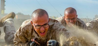 a group of marines crawl through sand