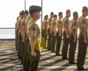 Marines line up on the deck of a ship