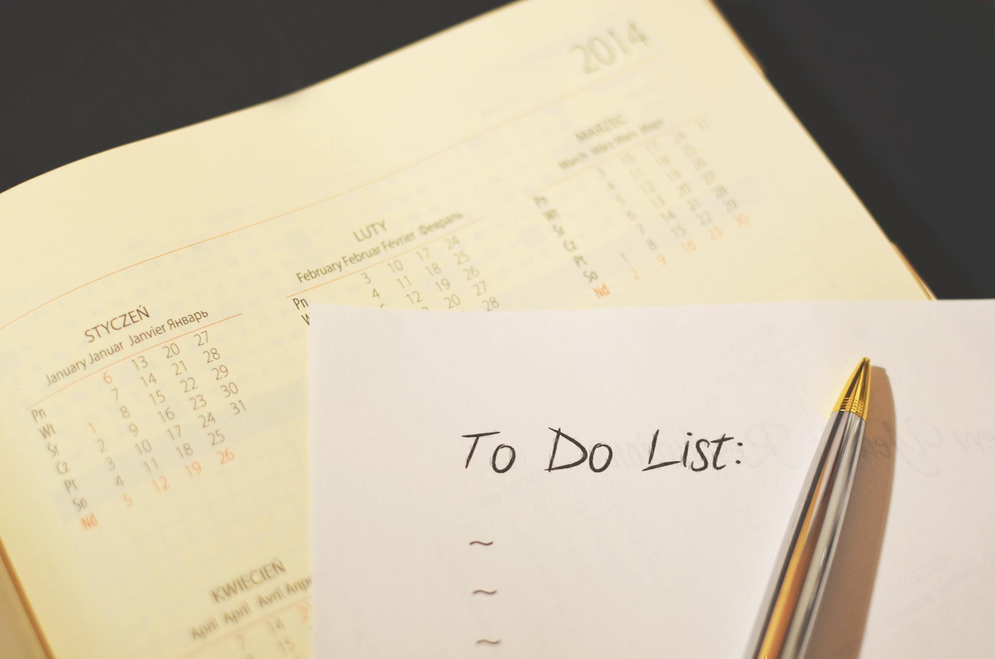 a to do list sits on top of a calendar