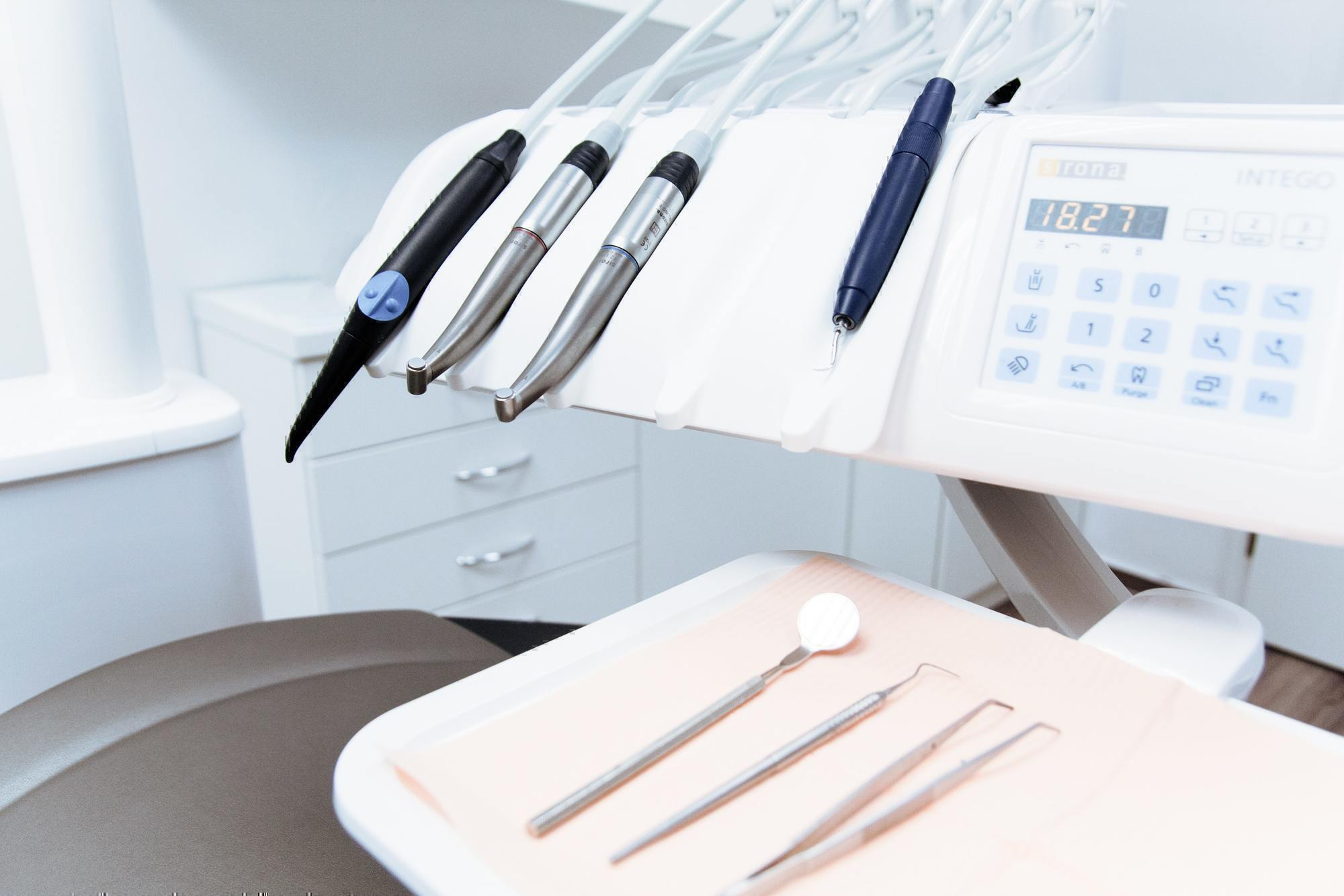 a set of dental tools sits in a dental office