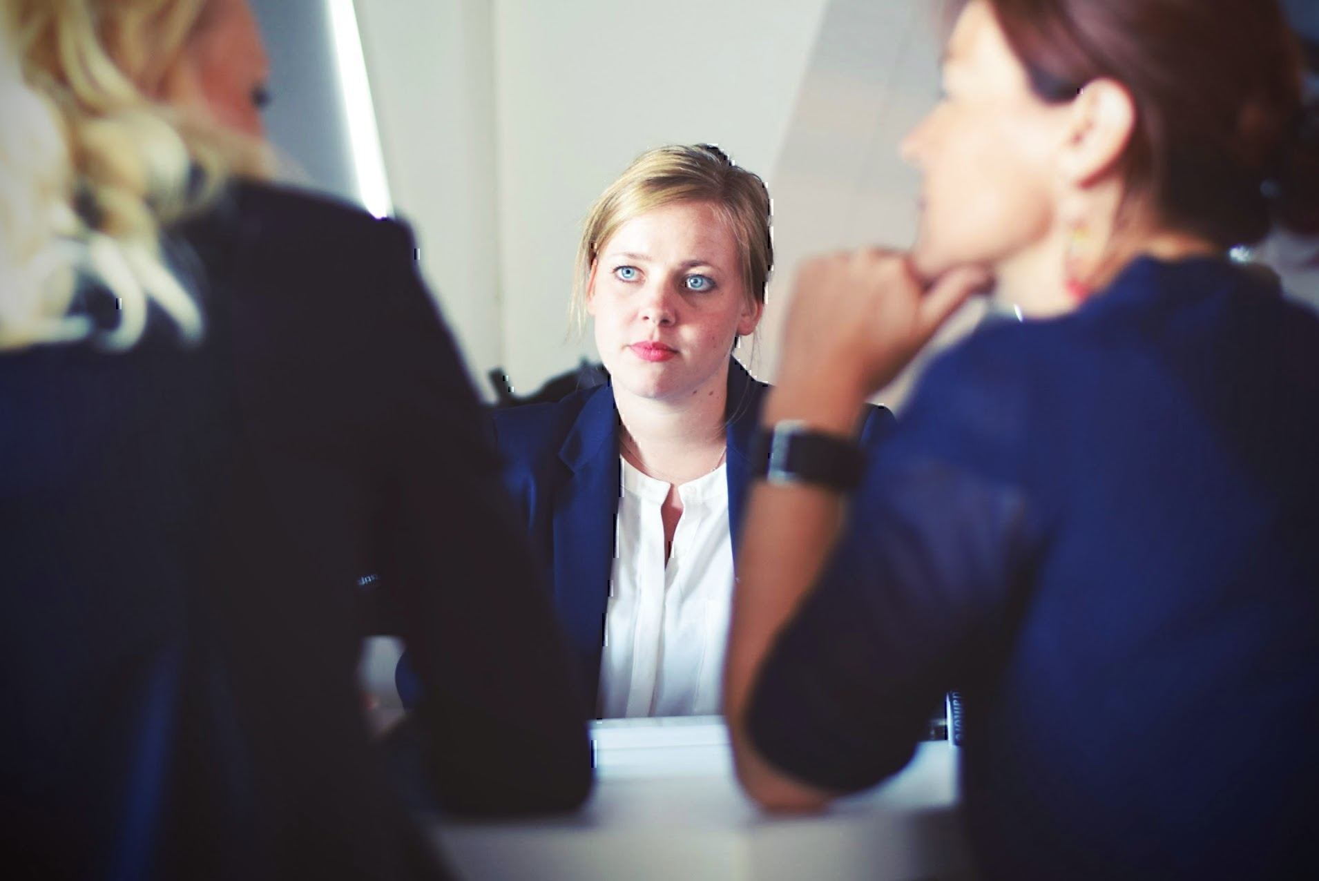 A female job candidate sits during a job interview