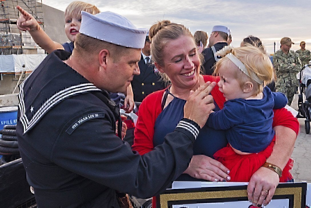 sailor talking to his wife and children