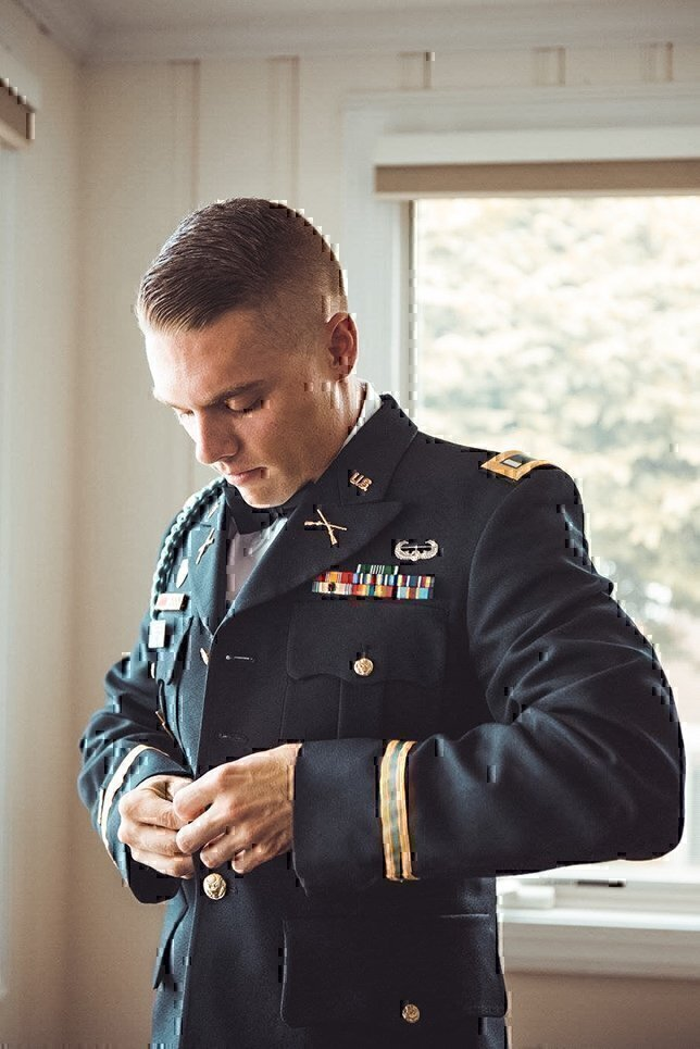 army infantry officer putting on his dress blue uniform