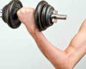 a man lifting a weight and flexing his arm
