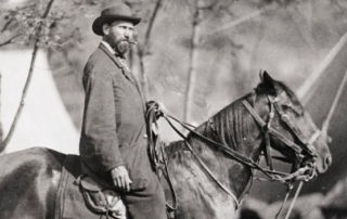 Alan Pinkerton sits on top of a horse