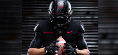 A football player models army's big red one uniform