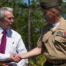 a marine meeting with a civilian shaking hands