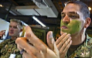 a man putting green face paint on
