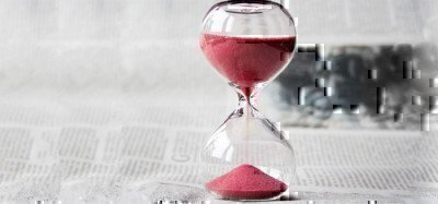 a picture of an hourglass on a newspaper