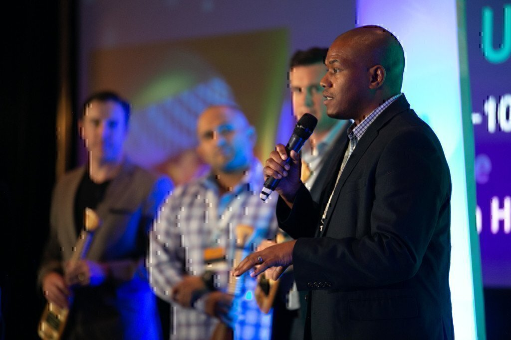 a picture of curtez riggs speaking at an event