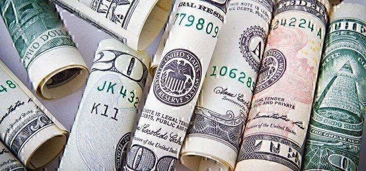 money rolled up together