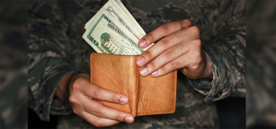 a man pulling money out of a wallet