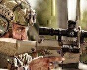 a man using a sniper rifle