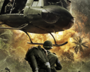 a picture of a soldier carrying another solider with a helicopter landing