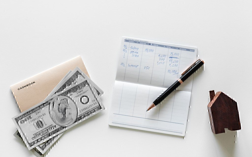a picture of a check book and money