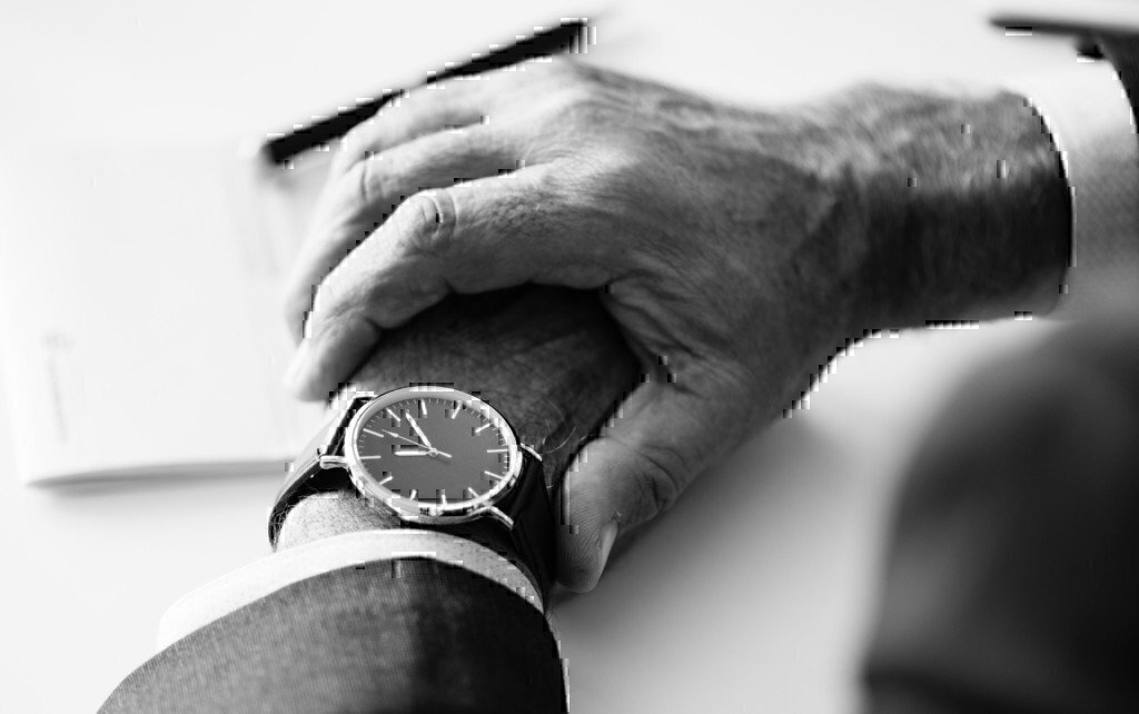 a guy checking a watch