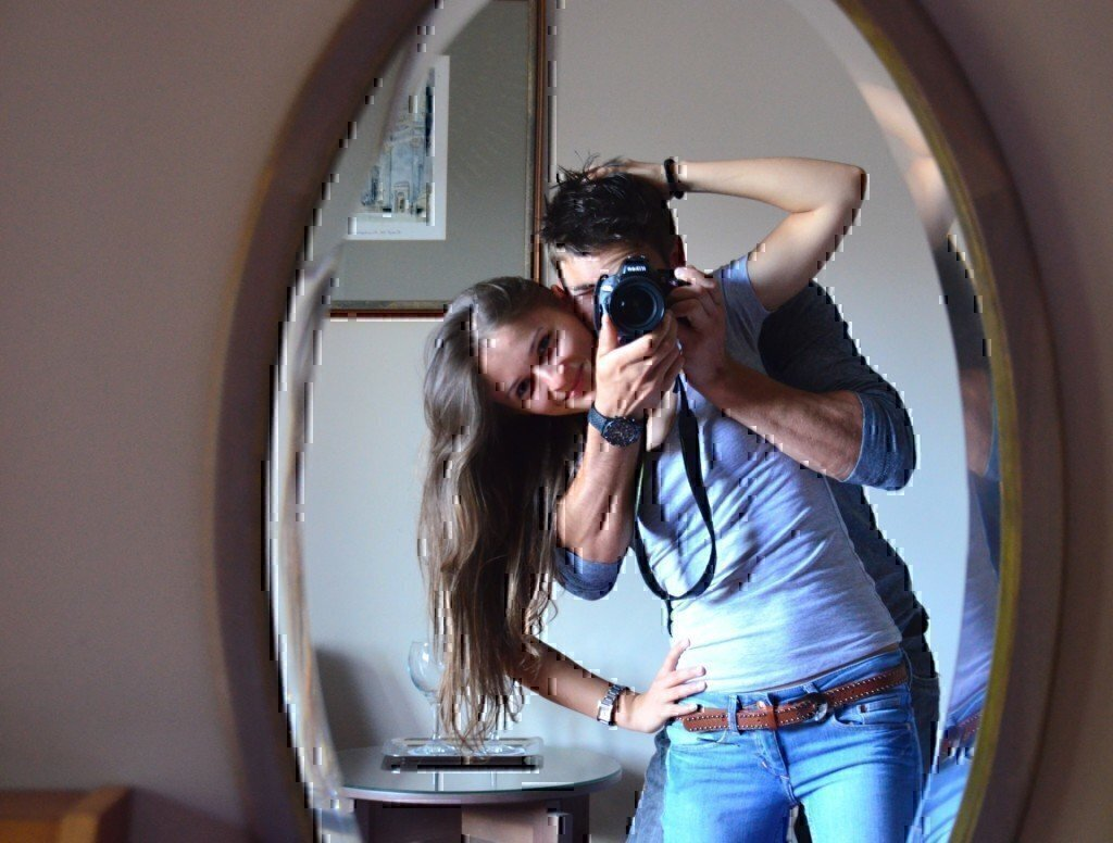 a picture of a couple in a mirror