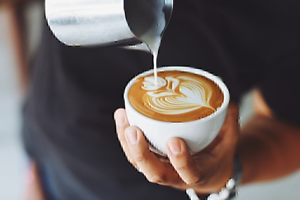 a picture of a man pouring coffee