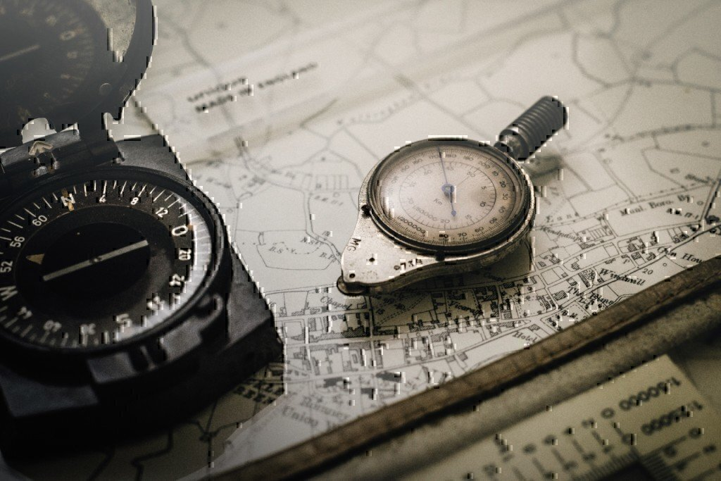 a picture of a compass and a map
