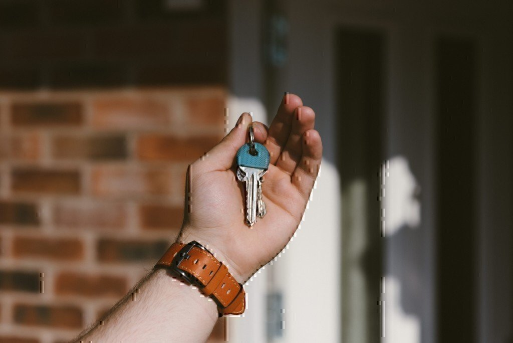 a picture of a man holding house keys