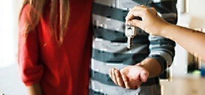 a couple grabbing keys when moving