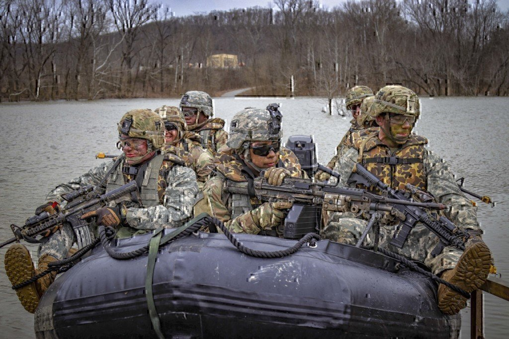 army soldiers moving in a boat