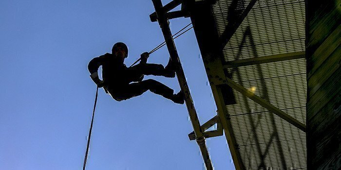 a picture of someone rappelling