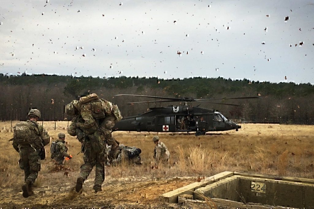 soldiers working together with a medical black hawk helicopter